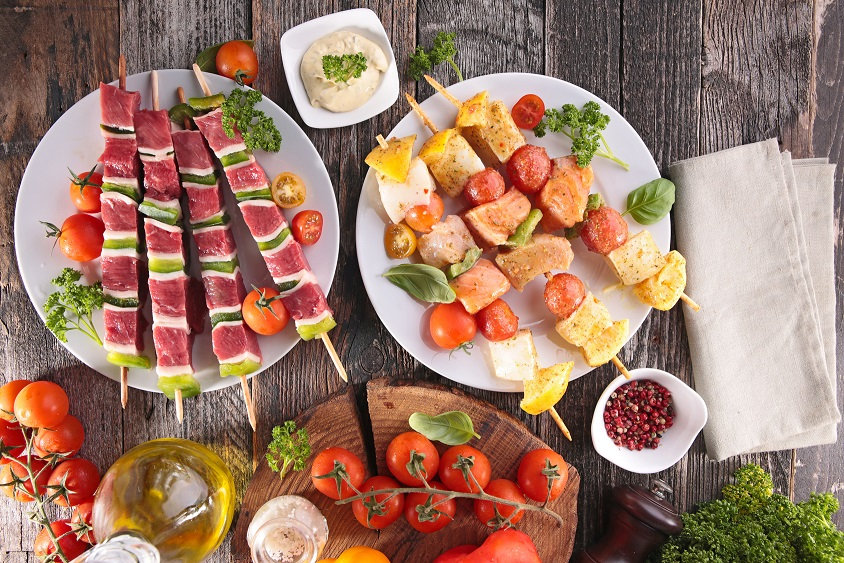 barbecue party with beef skewer and fish